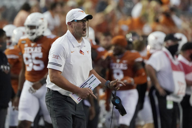 Texas coach Tom Herman shouts to his team during the first half of an NCAA college football game against UTEP in Austin, Texas, Saturday, Sept. 12, 2020. (AP Photo/Chuck Burton)