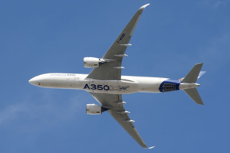 FILE PHOTO: An Airbus A350 takes off at the aircraft builder's headquarters in Colomiers near Toulouse