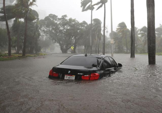 <p><strong>Miami</strong><br>A car is seen in a flooded street as Hurricane Irma passes through on Sept. 10, 2017 in Miami, Fla. Hurricane Irma made landfall in the Florida Keys as a Category 4 storm on Sunday, lashing the state with 130 mph winds as it moves up the coast. (Photo: Joe Raedle/Getty Images) </p>