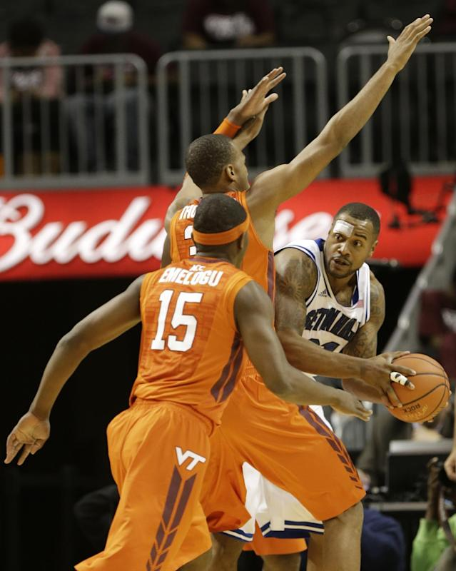 Seton Hall's Gene Teague, right, looks to pass away from Virginia Tech's Trevor Thompson and Ben Emelogu (15) during the first half of a consolation game in the Coaches vs. Cancer NCAA college basketball game on Saturday, Nov. 23, 2013, in New York. (AP Photo/Frank Franklin II)