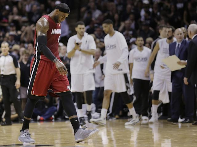 Miami Heat forward LeBron James (6) heads back to the bench against the San Antonio Spurs during the first half in Game 1 of the NBA basketball finals on Thursday, June 5, 2014, in San Antonio. (AP Photo/Eric Gay)