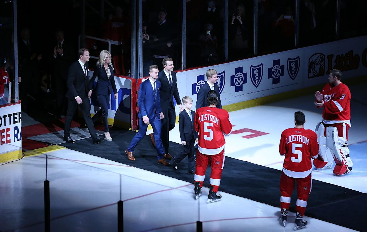 DETROIT, MI - MARCH 06: Former Detroit Red Wings Nick Lidstrom and his wife Annika and family enter the ice arena prior to the Nick Lidstrom jersey retirement ceremony at Joe Louis Arena on March 6, 2014 in Detroit, Michigan. (Photo by Leon Halip/Getty Images)