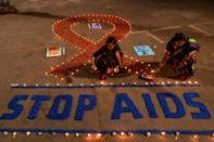 AIDS, by far the most deadly epidemic of modern times: according to UNAIDS some 32 million people around the world have died of the disease (AFP Photo/Dibyangshu SARKAR)