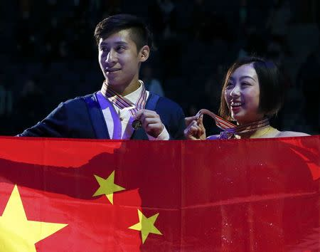 Figure Skating - ISU World Championships 2017 - Pairs Victory Ceremony - Helsinki, Finland - 30/3/17 - Gold medallists Sui Wenjing and Han Cong of China attend the ceremony. REUTERS/Grigory Dukor
