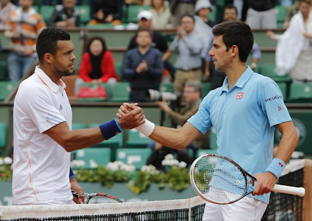 Serbia's Novak Djokovic, right, shakes hands with France's Jo-Wilfried Tsonga after their fourth round match of the French Open tennis tournament at the Roland Garros stadium, in Paris, France, Sunday, June 1, 2014. Djokovic won 6-1, 6-4, 6-1. (AP Photo/David Vincent)