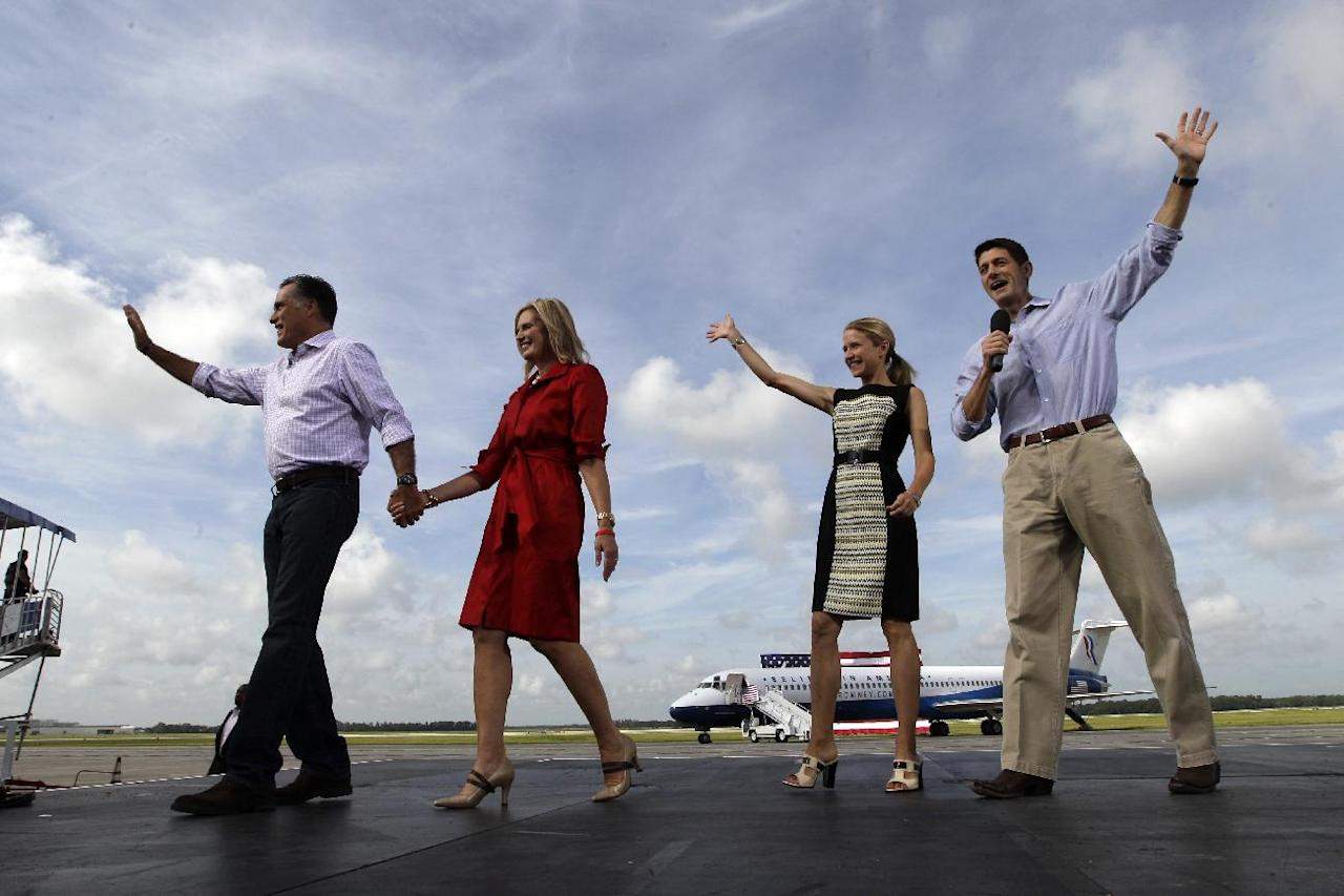 From left, Republican presidential nominee Mitt Romney, his wife Ann and his vice presidential running mate Rep. Paul Ryan, right, with his wife Janna, wave at supporters during a campaign event at Lakeland Linder Regional Airport, Friday, Aug. 31, 2012, Lakeland, Fla. (AP Photo/Mary Altaffer)