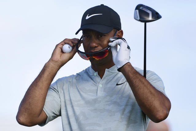 Tiger Woods adjusts his sunglasses before hitting from the seventh hole during the first round of the Hero World Challenge at the Albany Golf Club in Nassau, Bahamas, Thursday, Nov. 29, 2018. Woods now is No. 13 in the world as he hosts this holiday tournament for the 20th time. (AP Photo/Dante Carrer)