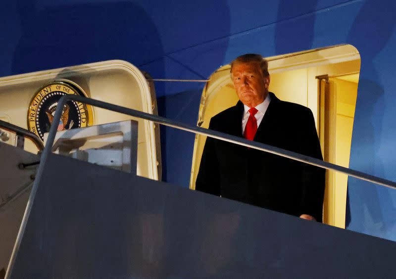 FILE PHOTO: U.S. President Donald Trump disembarks from Air Force One at Joint Base Andrews in Maryland