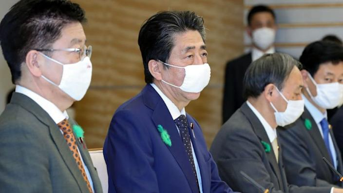 Prime Minister Shinzo Abe, centre, declared the state of emergency at a special meeting of medical experts