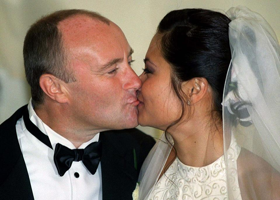 British rock star Phil Collins (L) kisses his former interpreter Orianne Cevey (R) during an exclusive wedding ceremony in the Beau Rivage hotel in Lausanne, Switzerland July 24. The couple had already officially wed in a civil ceremony away from the media glare on Friday in Begnins.