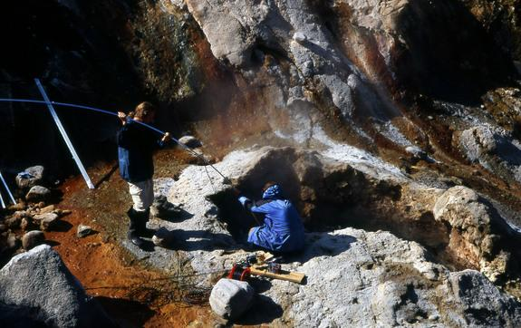 Alexander Belousov lowers a video camera into a geyser in Kamchatka.