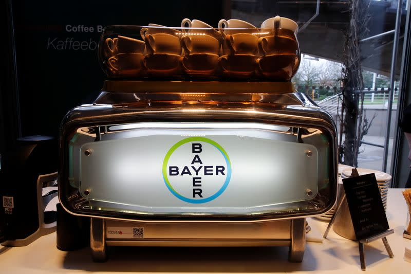 The logo of Bayer AG is seen at an espresso machine before German drugmaker's annual results news conference in Leverkusen