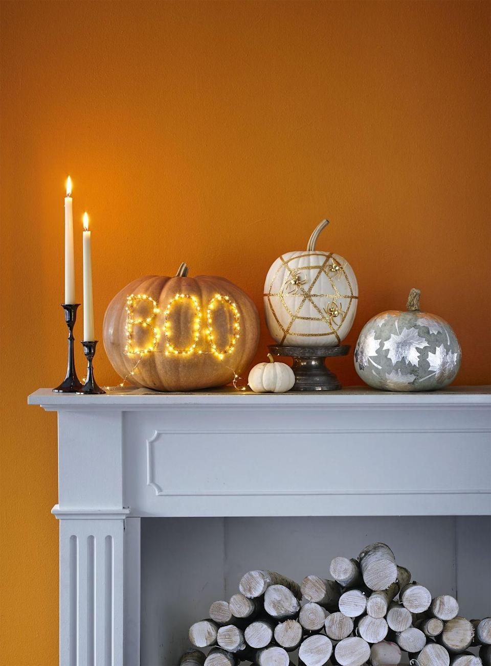 """<p>This shiny design looks great on any pumpkin, but works especially well on a green heirloom pumpkin. Outline several <a href=""""https://www.amazon.com/Maple-Stencils-16x20-11x14-Matboard/dp/B075ZJQG9N?tag=syn-yahoo-20&ascsubtag=%5Bartid%7C10070.g.331%5Bsrc%7Cyahoo-us"""" rel=""""nofollow noopener"""" target=""""_blank"""" data-ylk=""""slk:maple leaves"""" class=""""link rapid-noclick-resp"""">maple leaves</a> onto Fanci-Foil wrap and cut them out. Then use Mod Podge to adhere them to the pumpkin. To get the realistic leaf look, use a toothpick to draw on veins while the leaves are still drying.</p><p><a class=""""link rapid-noclick-resp"""" href=""""https://www.amazon.com/Wilton-804-123-Silver-Decorative-15-Feet/dp/B00BBBS7FM/?tag=syn-yahoo-20&ascsubtag=%5Bartid%7C10070.g.331%5Bsrc%7Cyahoo-us"""" rel=""""nofollow noopener"""" target=""""_blank"""" data-ylk=""""slk:SHOP FANCI-FOIL"""">SHOP FANCI-FOIL</a></p>"""