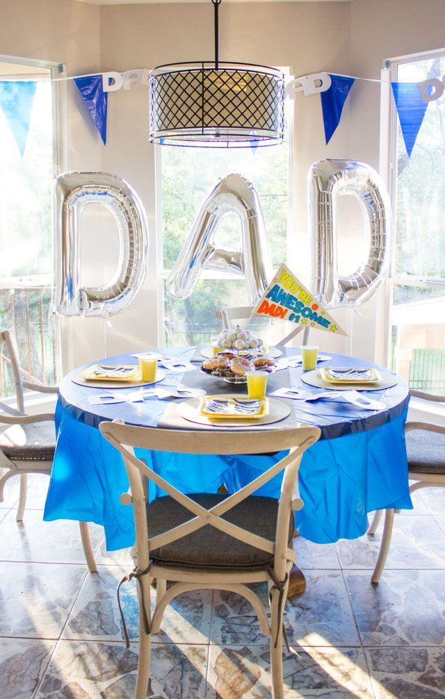 """<p>It's Dad's day, so he deserves a party in his honor. Set up the dining room before he wakes up, complete with balloons, a decorated table, and even DIY pennants and a trophy. </p><p><strong>Get the tutorial at <a href=""""https://designimprovised.com/2016/05/dad-is-rad-fathers-day-party-ideas.html"""" rel=""""nofollow noopener"""" target=""""_blank"""" data-ylk=""""slk:Design Improvised"""" class=""""link rapid-noclick-resp"""">Design Improvised</a>.</strong></p><p><a class=""""link rapid-noclick-resp"""" href=""""https://go.redirectingat.com?id=74968X1596630&url=https%3A%2F%2Fwww.walmart.com%2Fip%2FRoyal-Blue-Plastic-Party-Tablecloth-Round-84in%2F35760770%3FvariantFieldId%3Dactual_color&sref=https%3A%2F%2Fwww.thepioneerwoman.com%2Fholidays-celebrations%2Fg36333267%2Ffathers-day-activities%2F"""" rel=""""nofollow noopener"""" target=""""_blank"""" data-ylk=""""slk:SHOP TABLECLOTHS"""">SHOP TABLECLOTHS</a></p>"""