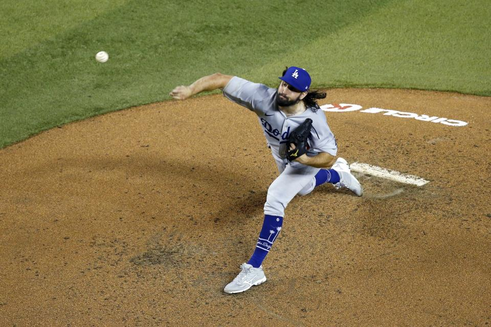 Los Angeles Dodgers starting pitcher Tony Gonsolin throws a pitch against the Arizona Diamondbacks during the fourth inning of a baseball game Friday, July 31, 2020, in Phoenix. (AP Photo/Ross D. Franklin)
