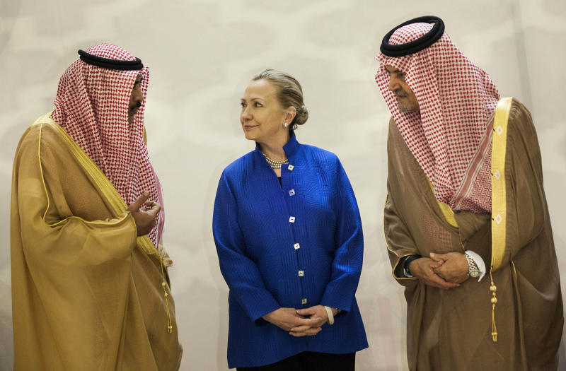 Saudi Foreign Minister Prince Saud Al-Faisal, right, U.S. Secretary of State Hillary Clinton and Kuwaiti Foreign Minister Sheikh Sabah Khaled al-Hamad Al-Sabah chat prior to a group photo before a US- Gulf Cooperation Council forum at the Gulf Cooperation Council Secretariat in Riyadh, Saudi Arabia, Saturday, March 31, 2012. Secretary Clinton is visiting the region to speak with leaders about local and global issues including Iran as well as attend talks aimed at ending the violence by the Assad regime towards its citizens in Syria.(AP Photo/Brendan Smialowski, Pool)