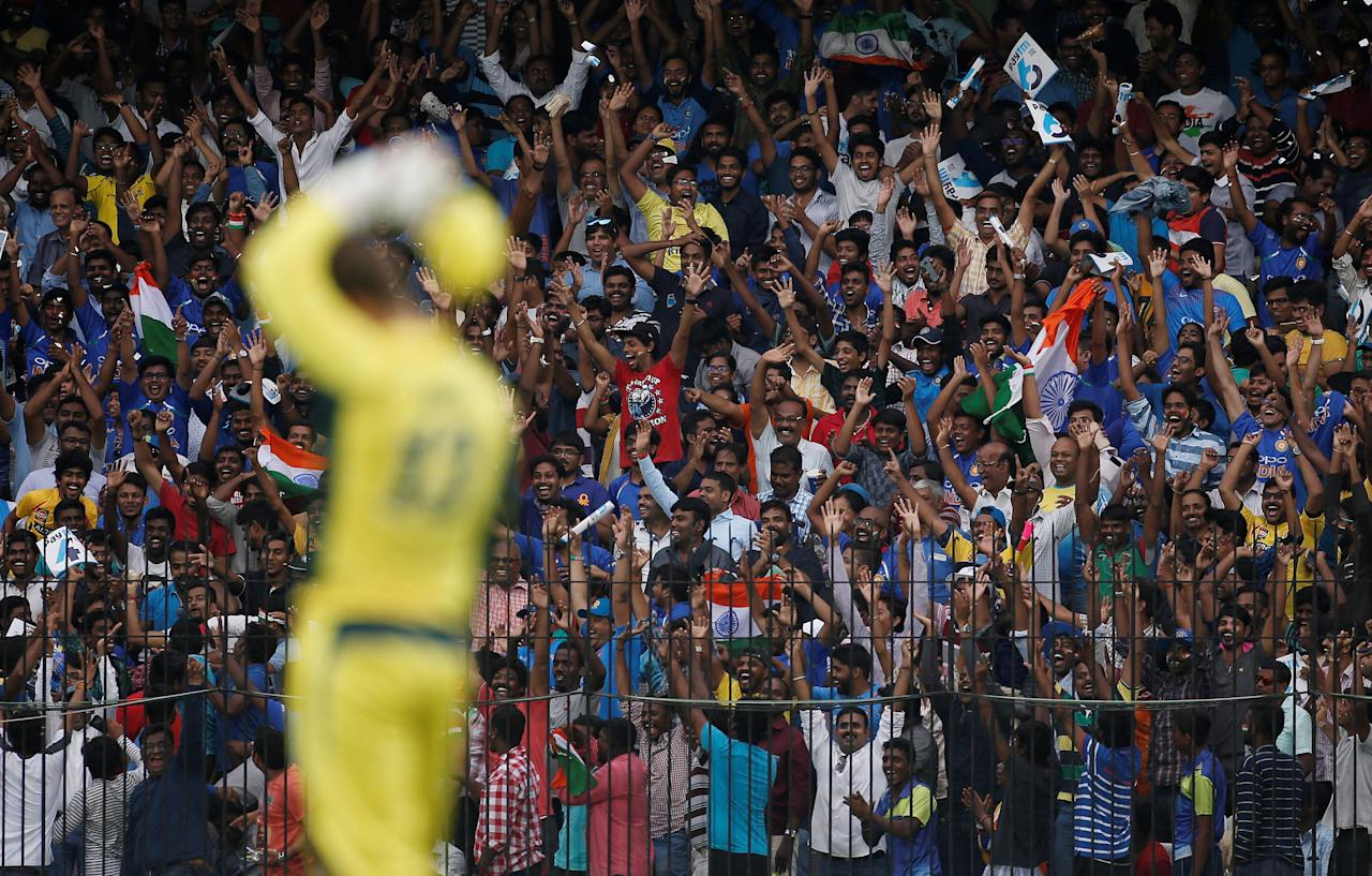 Cricket - India v Australia - First One Day International Match - Chennai, India – September 17, 2017 – Indian fans cheer their team as Australia's wicketkeeper Matthew Wade looks on. REUTERS/Adnan Abidi     TPX IMAGES OF THE DAY