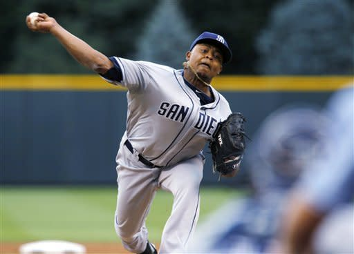 San Diego Padres starting pitcher Edinson Volquez throws to a Colorado Rockies batter during the first inning of a baseball game in Denver on Saturday, June 30, 2012. (AP Photo/David Zalubowski)