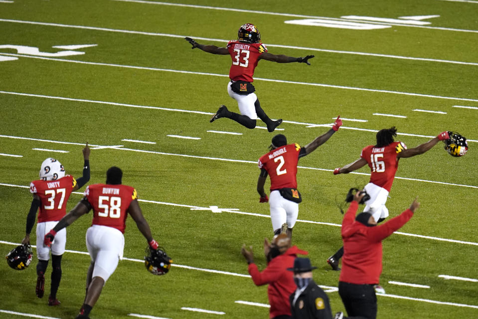 Maryland celebrate after defeating Minnesota during overtime of an NCAA college football game, Friday, Oct. 30, 2020, in College Park, Md. Maryland won 45-44 in overtime. (AP Photo/Julio Cortez)