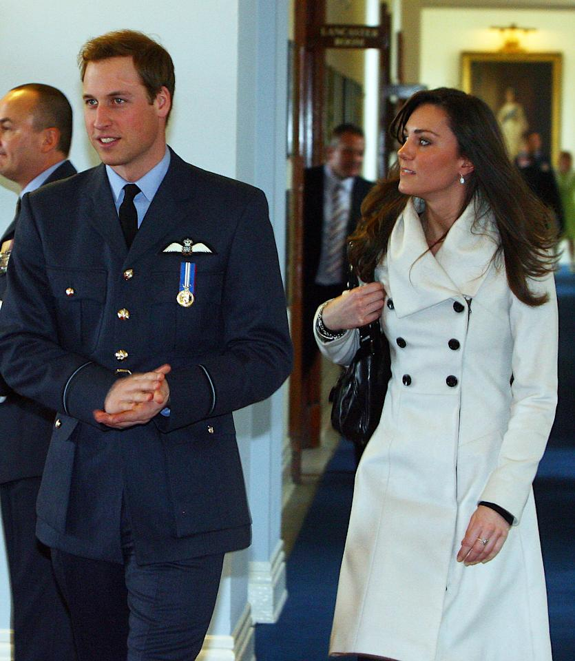 Britain's Prince William (L) is pictured with his girlfriend Kate Middleton after his graduation ceremony at RAF Cranwell air base in Lincolnshire, on April 11, 2008. Britain's Prince William graduated as a Royal Air Force (RAF) pilot on Friday after successfully completing an intensive flying course.The prince, 25, received his wings from his father Prince Charles in a graduation ceremony at the RAF Cranwell air base in Lincolnshire, east central England. AFP PHOTO/PAUL ELLIS/POOL (Photo credit should read PAUL ELLIS/AFP via Getty Images)