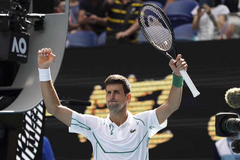 Serbia's Novak Djokovic celebrates after defeating Japan's Yoshihito Nishioka in their third round match at the Australian Open tennis championship in Melbourne, Australia, Friday, Jan. 24, 2020. (AP Photo/Lee Jin-man)