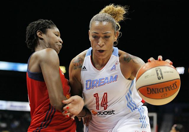 Atlanta Dream center Aneika Henry (14) drives to the basket as Washington Mystics center Michelle Snow defends in the first quarter of Game 3 of aWNBA basketball Eastern Conference semifinal series, Monday, Sept. 23, 2013, in Atlanta. (AP Photo/Todd Kirkland)