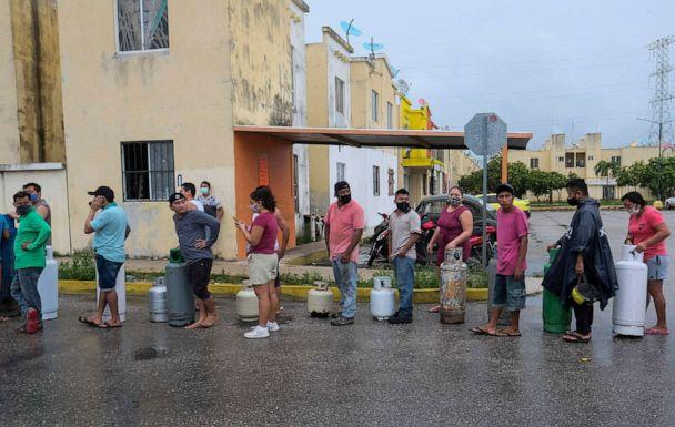 PHOTO: People line up to buy gas prior to the arrival of Hurricane Delta in Cancun, Mexico, Oct. 6, 2020. Delta rapidly intensified into a potentially catastrophic Category 4 hurricane on a course to hit Mexico and continue on to the U.S. Gulf coast.  (Victor Ruiz Garcia/AP)