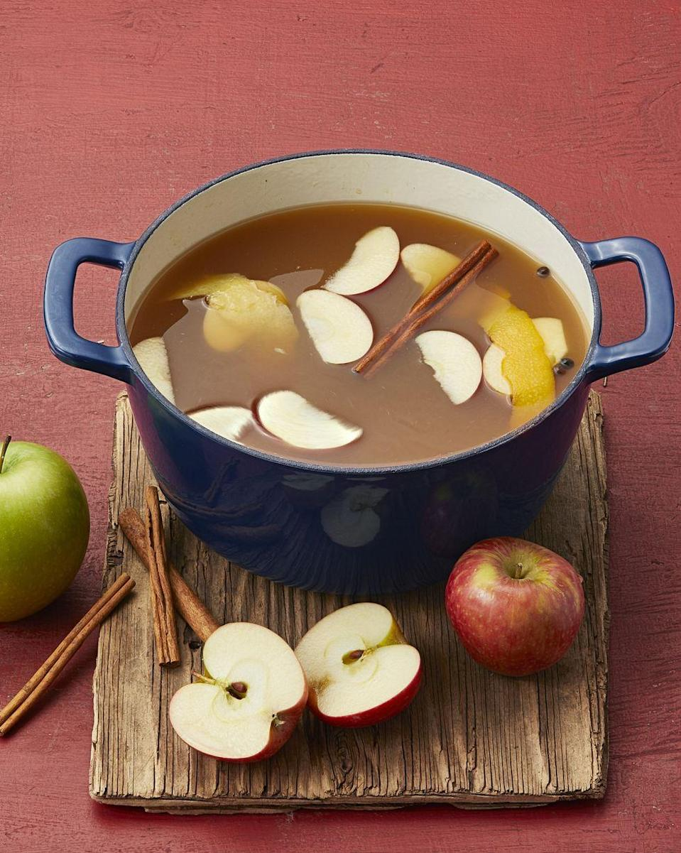 """<p>Keep a <del>pot</del> cauldron of this warm apple cider on the stove to serve to guests as they come in from the cold. You can even spike it with a bit of dark rum for an adults-only party!</p><p><a href=""""https://www.thepioneerwoman.com/food-cooking/recipes/a10425/mulled-apple-cider/"""" rel=""""nofollow noopener"""" target=""""_blank"""" data-ylk=""""slk:Get Ree's recipe."""" class=""""link rapid-noclick-resp""""><strong>Get Ree's recipe. </strong></a></p><p><a class=""""link rapid-noclick-resp"""" href=""""https://go.redirectingat.com?id=74968X1596630&url=https%3A%2F%2Fwww.walmart.com%2Fsearch%2F%3Fquery%3Dpioneer%2Bwoman%2Bpots&sref=https%3A%2F%2Fwww.thepioneerwoman.com%2Fholidays-celebrations%2Fg36982659%2Fhalloween-drink-recipes%2F"""" rel=""""nofollow noopener"""" target=""""_blank"""" data-ylk=""""slk:SHOP POTS"""">SHOP POTS</a></p>"""