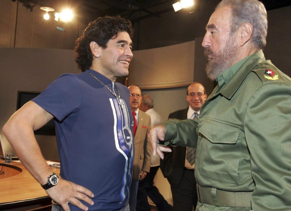 "FILE - In this Oct. 27, 2005 file photo released by the Cuban government's National Information Agency (AIN), Cuban President Fidel Castro, right, meets Argentina's former soccer star Diego Maradona on the program ""Mesa Redonda"" in Havana, Cuba. The Argentine soccer great who was among the best players ever and who led his country to the 1986 World Cup title before later struggling with cocaine use and obesity, died from a heart attack on Wednesday, Nov. 25, 2020, at his home in Buenos Aires. He was 60. (AIN/Ismael Francisco via AP)"