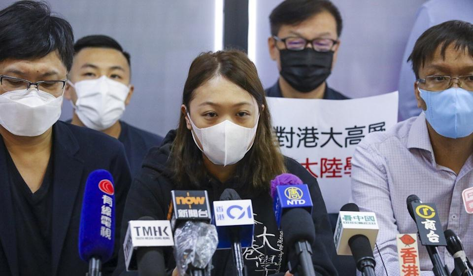 Jeh Tsz-lam, president of the University of Hong Kong Students' Union (centre), and district councillor Roy Tam Hoi-pong (right) call for the university to decline hiring two mainland Chinese professors. Photo: Dickson Lee