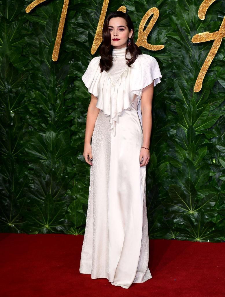 <p>Jenna Coleman gave us all the wintry vibes in a silky, ruffled dress finished with a lick of berry lipstick. <em>[Photo: Getty]</em> </p>