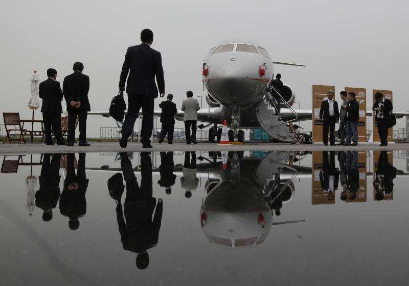 Visitors tour the Bombardier Global Express XRS corporate jet during the Asian Aerospace Show in Hong Kong Tuesday, March 8, 2011. Canada's Bombardier, Brazil's Embraer, and other makers of smaller jets are also on hand at the air show, underscoring their desire to cash in on opportunities for sales of corporate and private jets. (AP Photo/Kin Cheung)