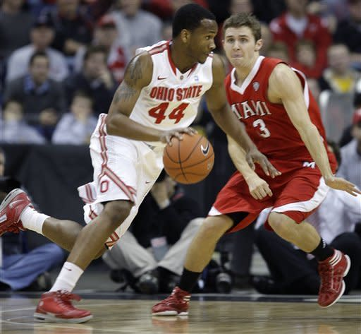 Ohio State's William Buford, left, drives to the basket against Miami (Ohio)'s Will Sullivan during the first half of an NCAA college basketball game, Thursday, Dec. 22, 2011, in Columbus, Ohio. Ohio State won 69-40. (AP Photo/Jay LaPrete)