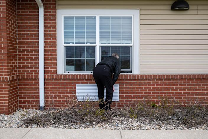 Duane Zenn visits his mother, Mary Ellen Zenn, during a nursing home window visit Friday, April 23, 2021, at Prairie Lakes Health Campus in Noblesville, Ind. Zenn says the window visit is due to a COVID-19 case inside the nursing home but should be able to visit his mother in person in four days. Mary Ellen was a resident at another nursing home earlier this year, Miller's Senior Living Community in Castleton, when a bedsore on her heel sent her to the hospital. The sore was so badly infected that gangrene had set in, and her right leg had to be amputated above the knee.