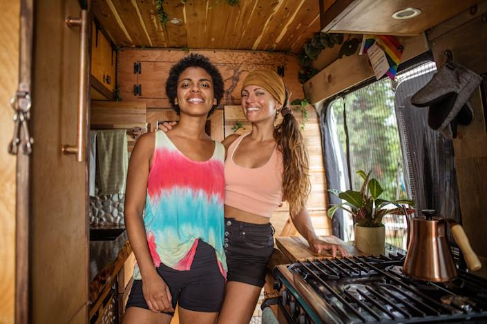 Nat and Abi pose in the kitchen