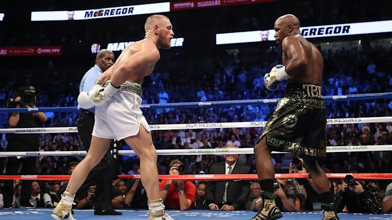 McGregor mocks Mayweather in the ring. Pic: Getty