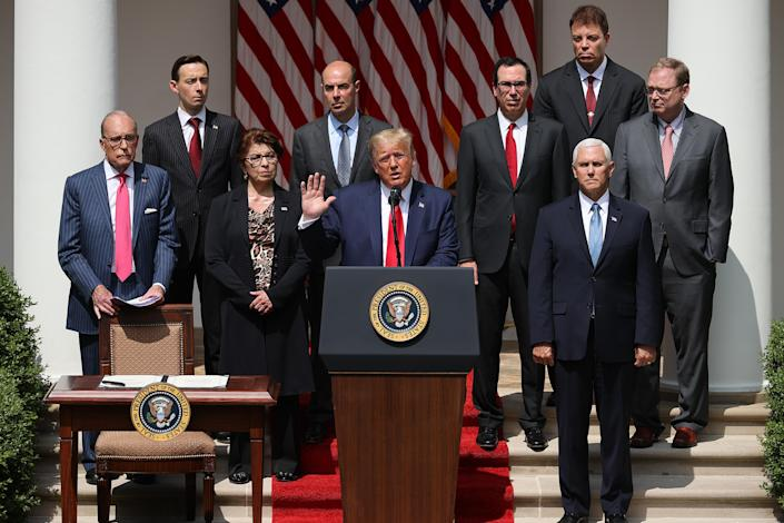 President Trump speaks during a news conference in the Rose Garden at the White House on Friday. The U.S. Labor Department announced the unemployment rate fell to 13.3 percent in May, a surprising improvement in the nation's job market. (Chip Somodevilla/Getty Images)
