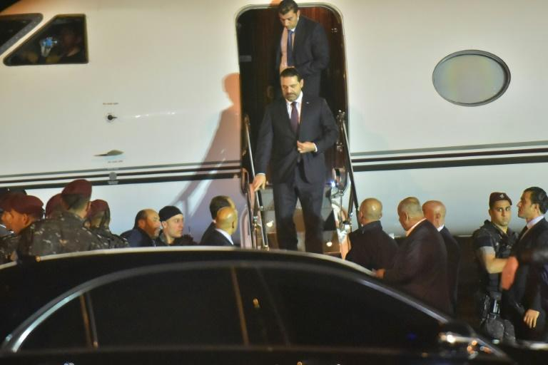 Lebanese Prime Minister Saad Hariri (C) arrives at Beirut International Airport after a nearly three-week absence dominated by his surprise resignation