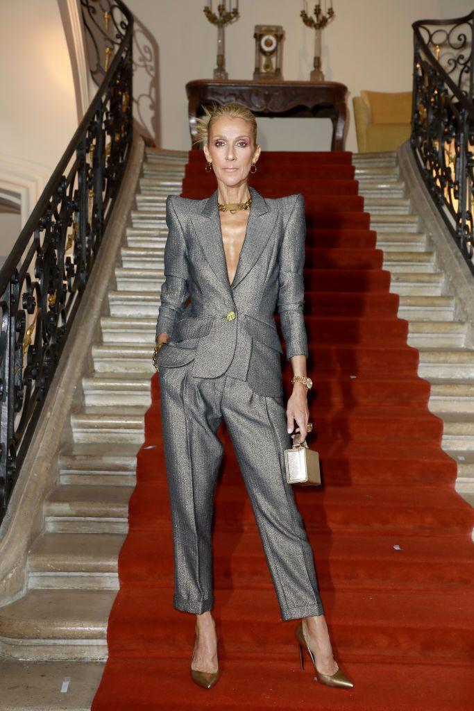 <p>The singer stuns in a grey suit. The plunging neckline, exaggerated shoulder silhouette, and relaxed-fit trousers are an impossibly stylish take on the standard suit. The gold accessories add a gilded touch.</p>