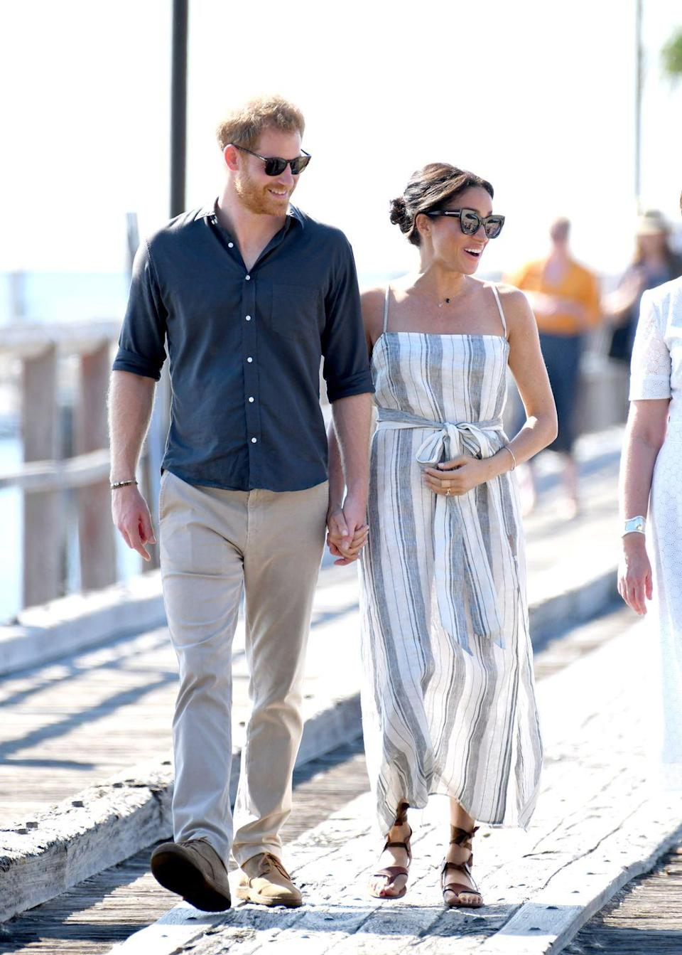 <p>The Royal couples visited the Kingfisher Bay Jetty on Fraser Island. Meghan and Harry greeted the crowd and received multiple gifts for their expected child. </p>