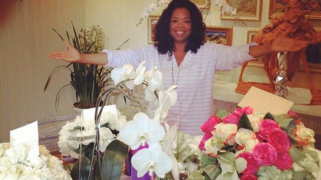 Oprah Strains Back Lifting Gift from Tyler Perry