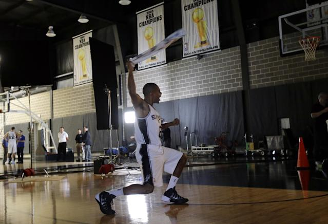 San Antonio Spurs' Patty Mills, of Australia, poses for a photo at the team's workout facility during their NBA basketball media day, Monday, Sept. 30, 2013, in San Antonio. (AP Photo/Eric Gay)