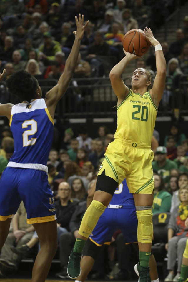 Oregon's Sabrina Ionescu, right, shots over UC Riverside's Marina Ewodo during the first quarter of an NCAA college basketball game in Eugene, Ore., Monday, Dec. 16, 2019. (AP Photo/Chris Pietsch)