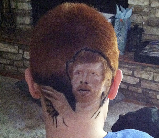 This family photo shows Patrick Gonzalez, 12, with an image of San Antonio Spurs' Matt Bonner shaved into his head, at his home in San Antonio on Tuesday, May 15, 2012. Gonzalez was suspended for a day from Woodlake Hills Middle School because the district deemed his $75 haircut a distraction. He returned to class Thursday after reluctantly shaving his head. (AP Photo/Rachel Delgado)