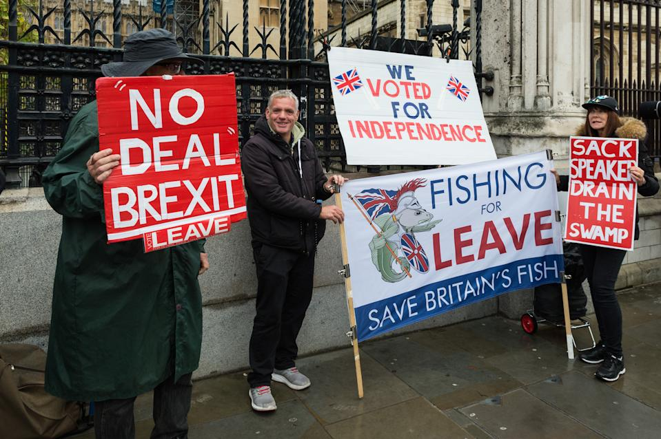 Pro-Brexit supporters protest outside the Houses of Parliament on 21 October, 2019 in London, England. Today, the government will attempt to bring a vote on Boris Johnson's EU withdrawal agreemnet after MPs witheld their support for the deal on Saturday to prevent a no-deal Brexit on 31st October, forcing prime minster to write a letter requesting an extension from the EU. (Photo by WIktor Szymanowicz/NurPhoto via Getty Images)