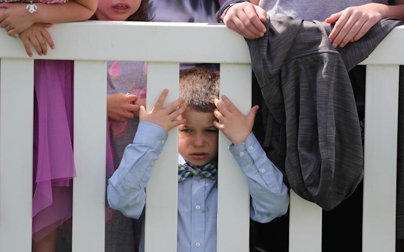 A child awaits the arrival of President Trump