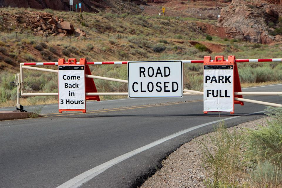 Cars were forced to turn around for hours at a time during busy September weekends at Arches National Park in Moab, Utah. Fearing overcrowding amid the coronavirus pandemic, the park has closed every day in October to try to curb crowds.