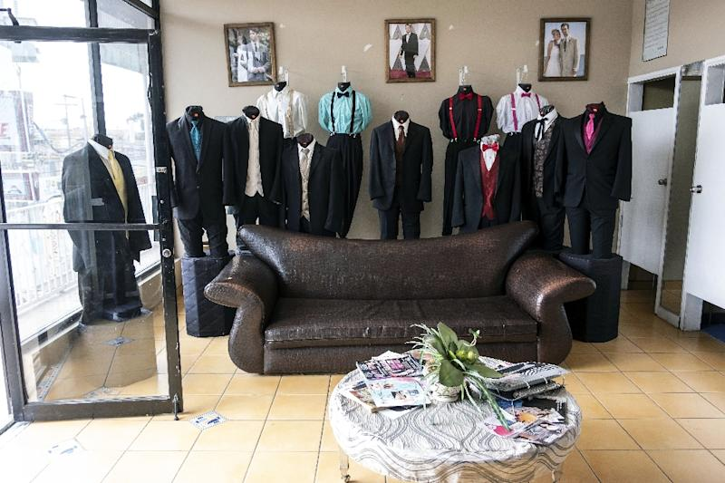 A view inside Martinez Tuxedos, where Thomas Markle tried to stage photographs before settling for images of an assistant at a party supply shop measuring him for a suit (AFP Photo/GUILLERMO ARIAS)