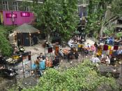This Saturday May 22, 2021 taken photo shows people sitting at the 'Wilde Renate' beer garden in Berlin, Germany. Several of the German capital's nightspots have managed a limited restart along with pubs and restaurants over Pentecost weekend. (AP Photo/Dorothee Thiesing)