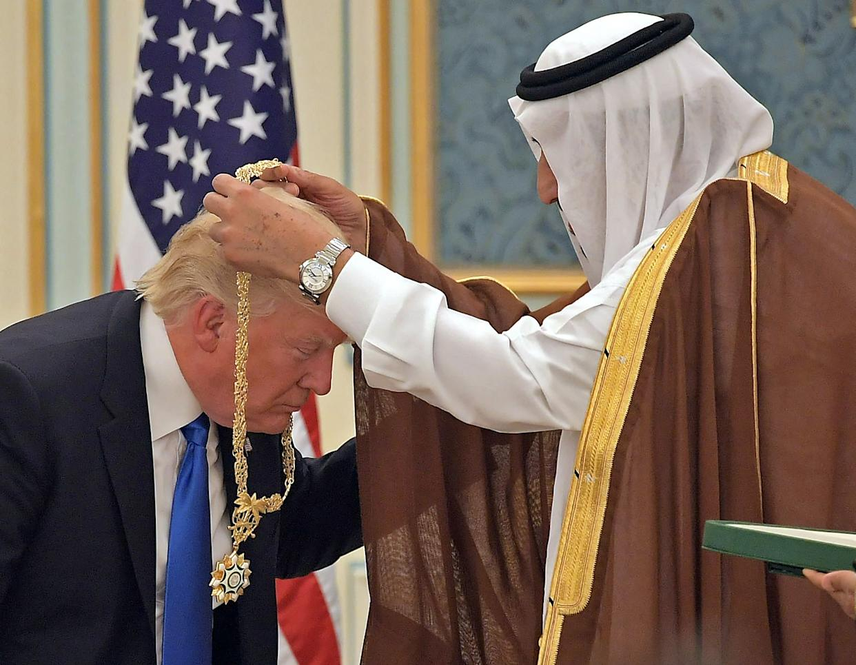 Trump receives the Order of Abdul-Aziz Al Saud medal from King Salman at the Saudi Royal Court in Riyadh on May 20, 2017.